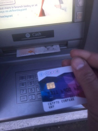 using an atm with a bitcoin debit card